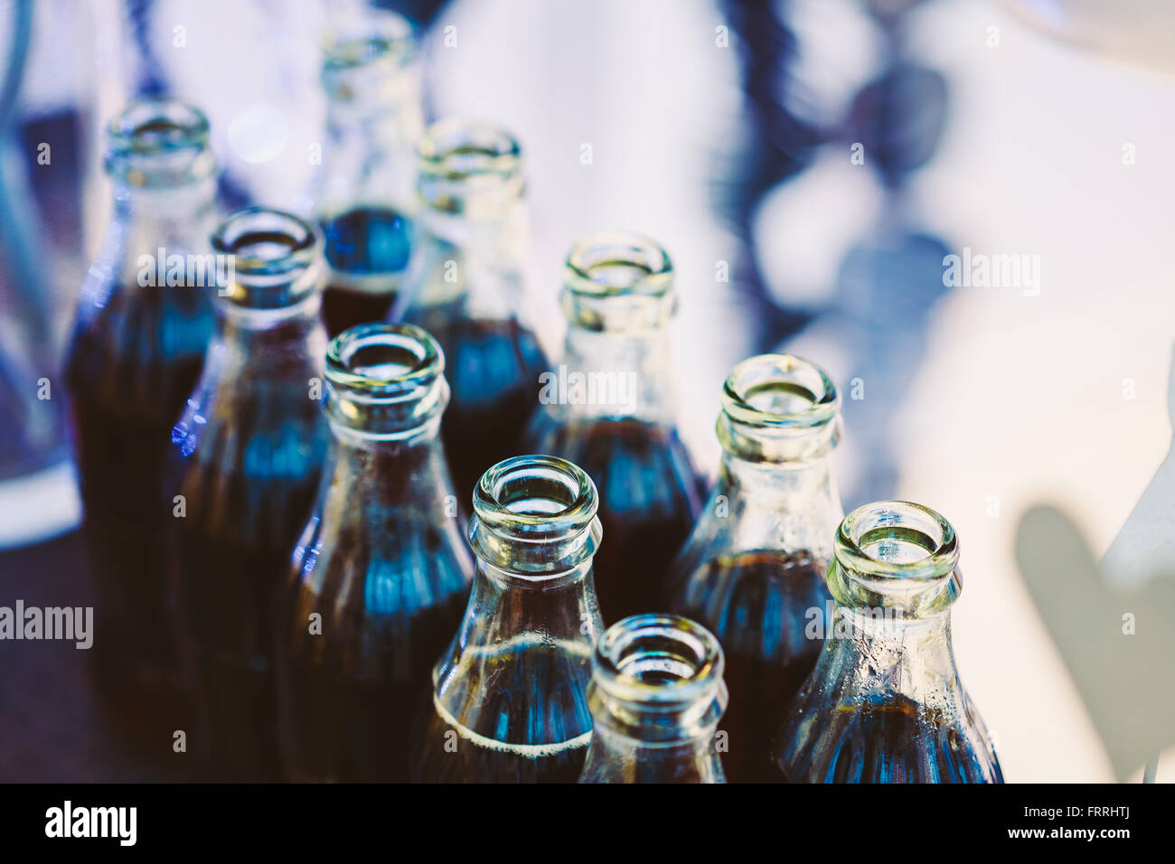 Refreshing Brown Soda in bottles in Candy Bar On Table. Delicious sweet buffet. - Stock Image