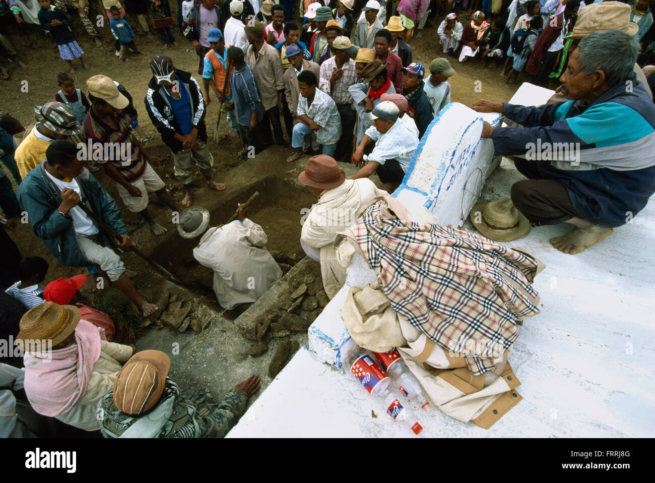 A family grave is opened at a reburial ceremony in Belaveno, Bezanozano Ethnic Area, Madagascar. - Stock Image