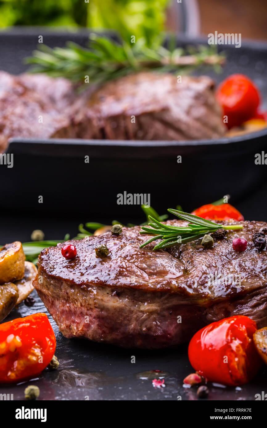 Steak. Grill beef steak. Portions thick beef juicy sirloin steaks on grill teflon pan or granite board. - Stock Image