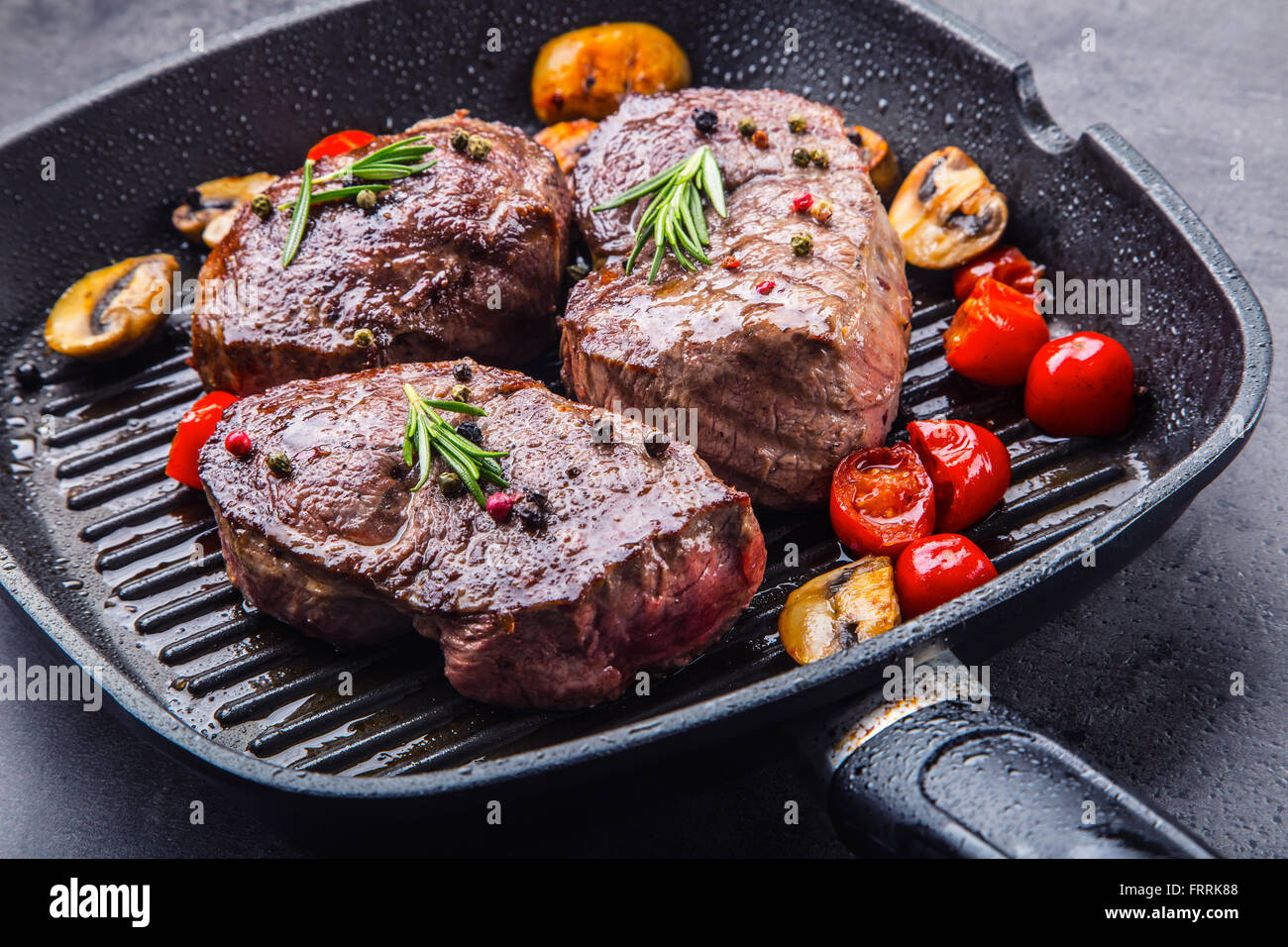 Steak. Grill beef steak. Portions thick beef juicy sirloin steaks on grill teflon pan or granite board. - Stock Image
