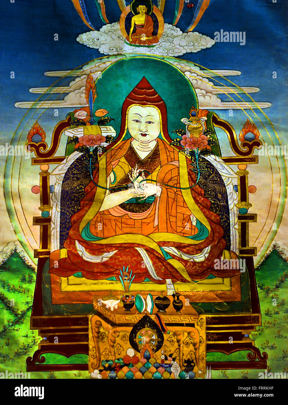 This scroll painting, thangka, shows a teacher, Lama, on a throne with his hands in dharmacakramudra. In each of - Stock Image