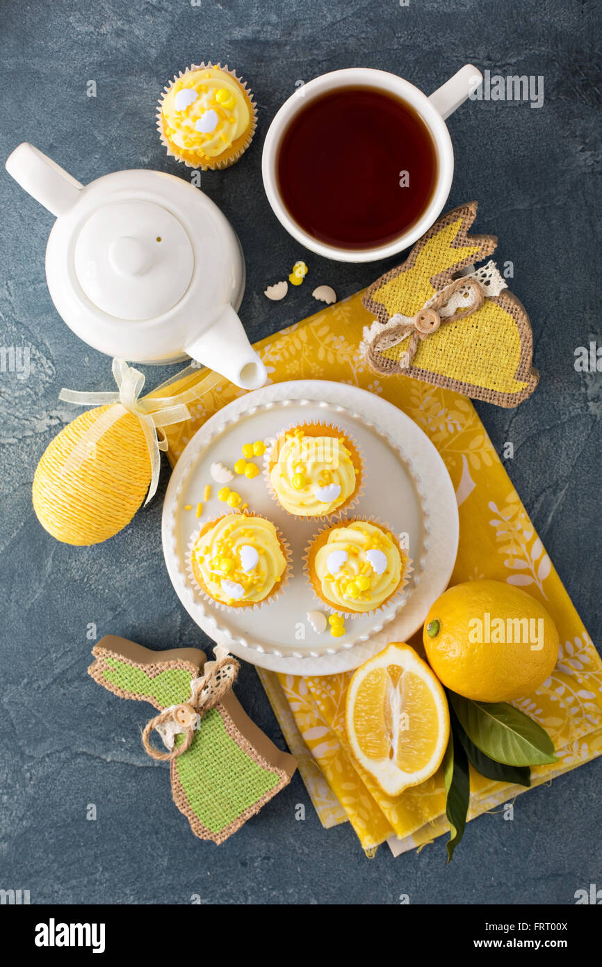 Easter background with lemon cupcakes - Stock Image