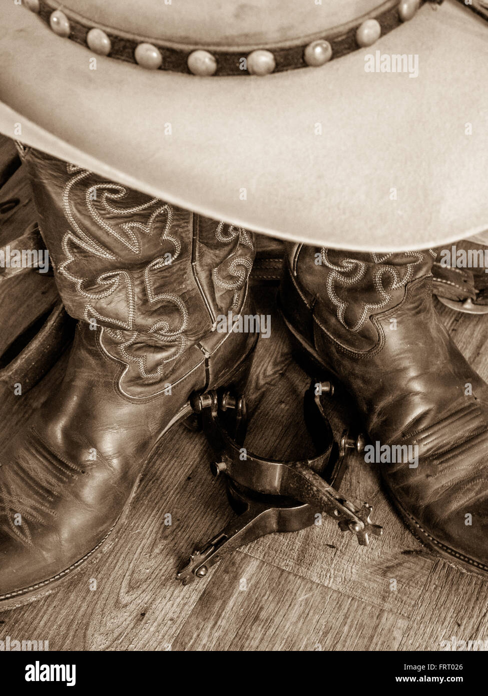 Cowboy spurs, hat and boots - Stock Image