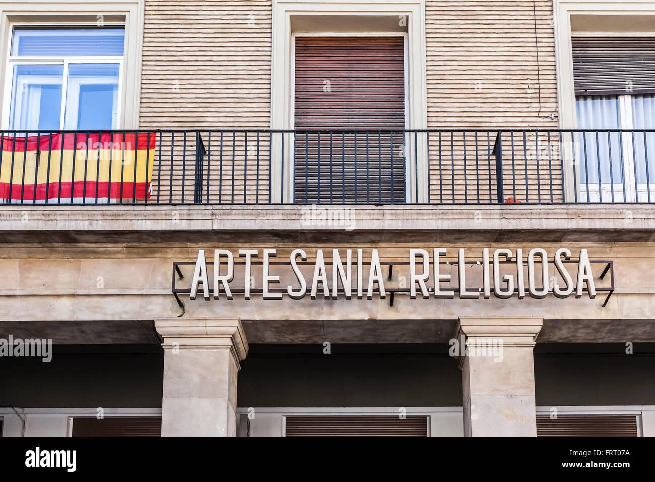 Sign Artesania religiosa balcony flag,Zaragoza,Aragón,Spain. Stock Photo