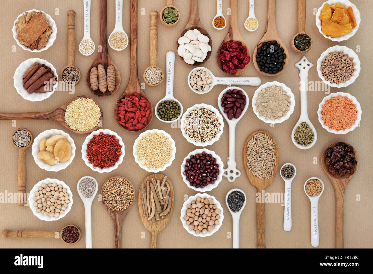 Large superfood sampler for good health in spoons and bowl forming an abstract background. High in antioxidants Stock Photo