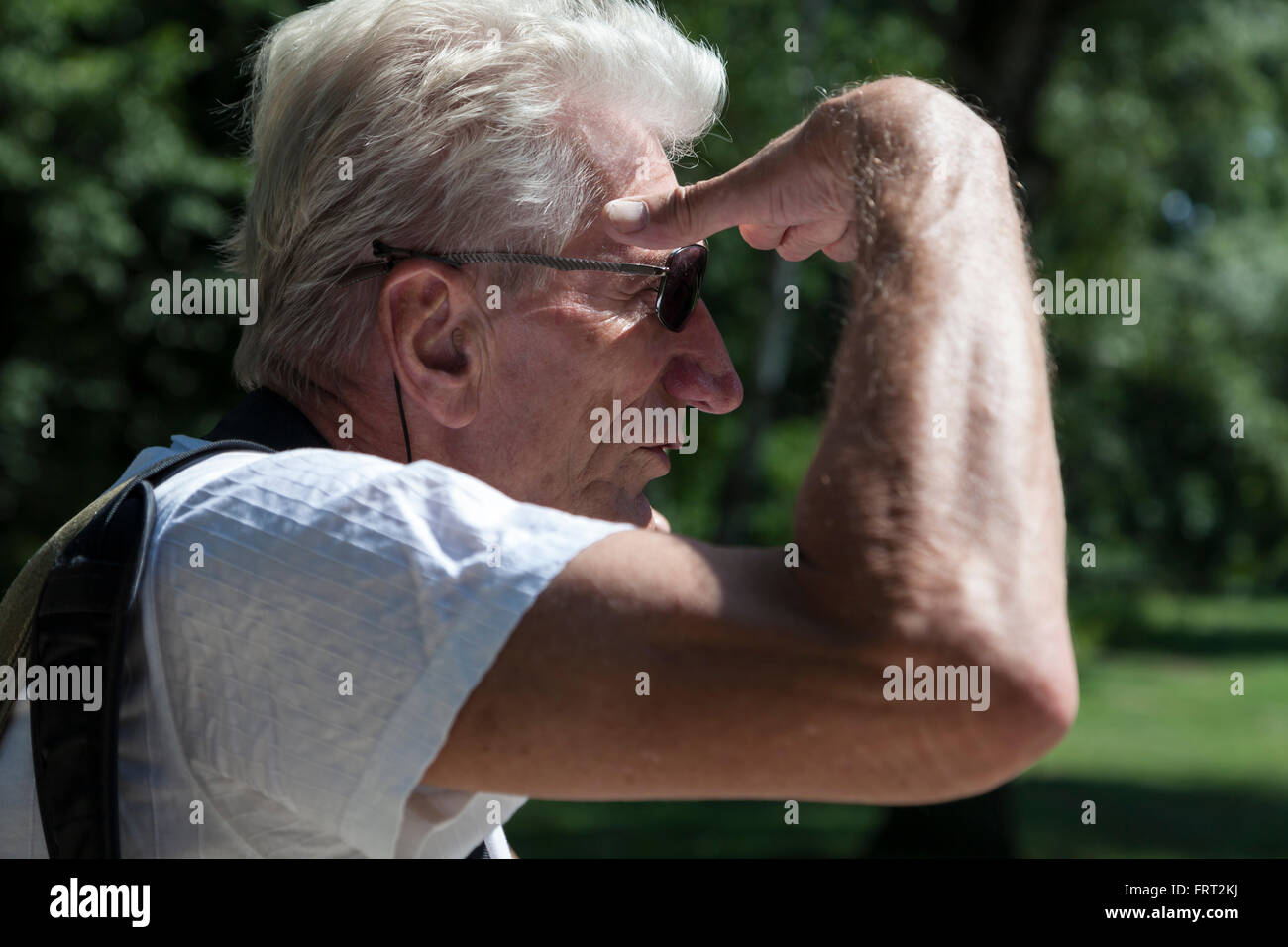 Man is looking for something - Stock Image