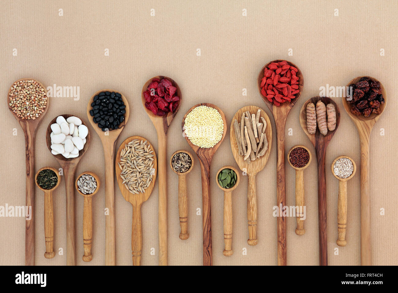 Superfood for good health in wooden spoons forming an abstract background with copy space. High in antioxidants - Stock Image