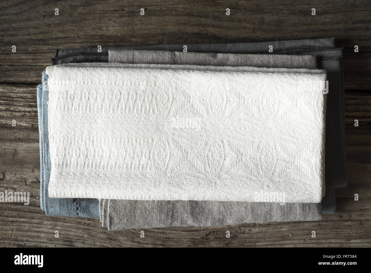 Napkin set on the wooden table top view - Stock Image