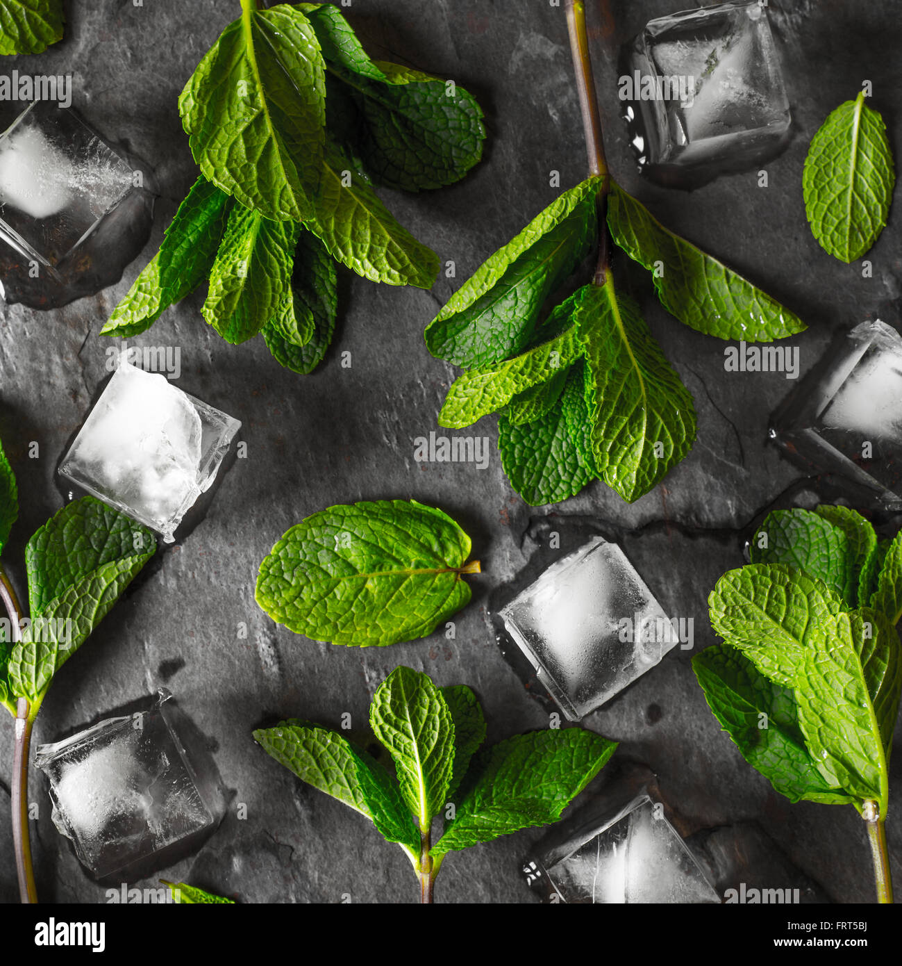 Fresh mint with ice cube on the stone table square - Stock Image
