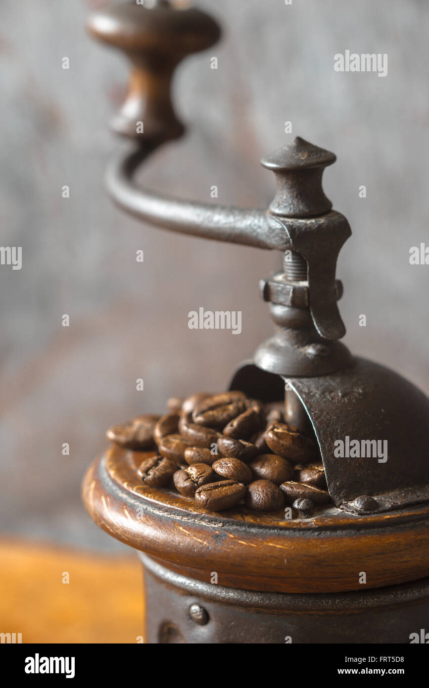 Coffee mill with coffee beans vertical - Stock Image