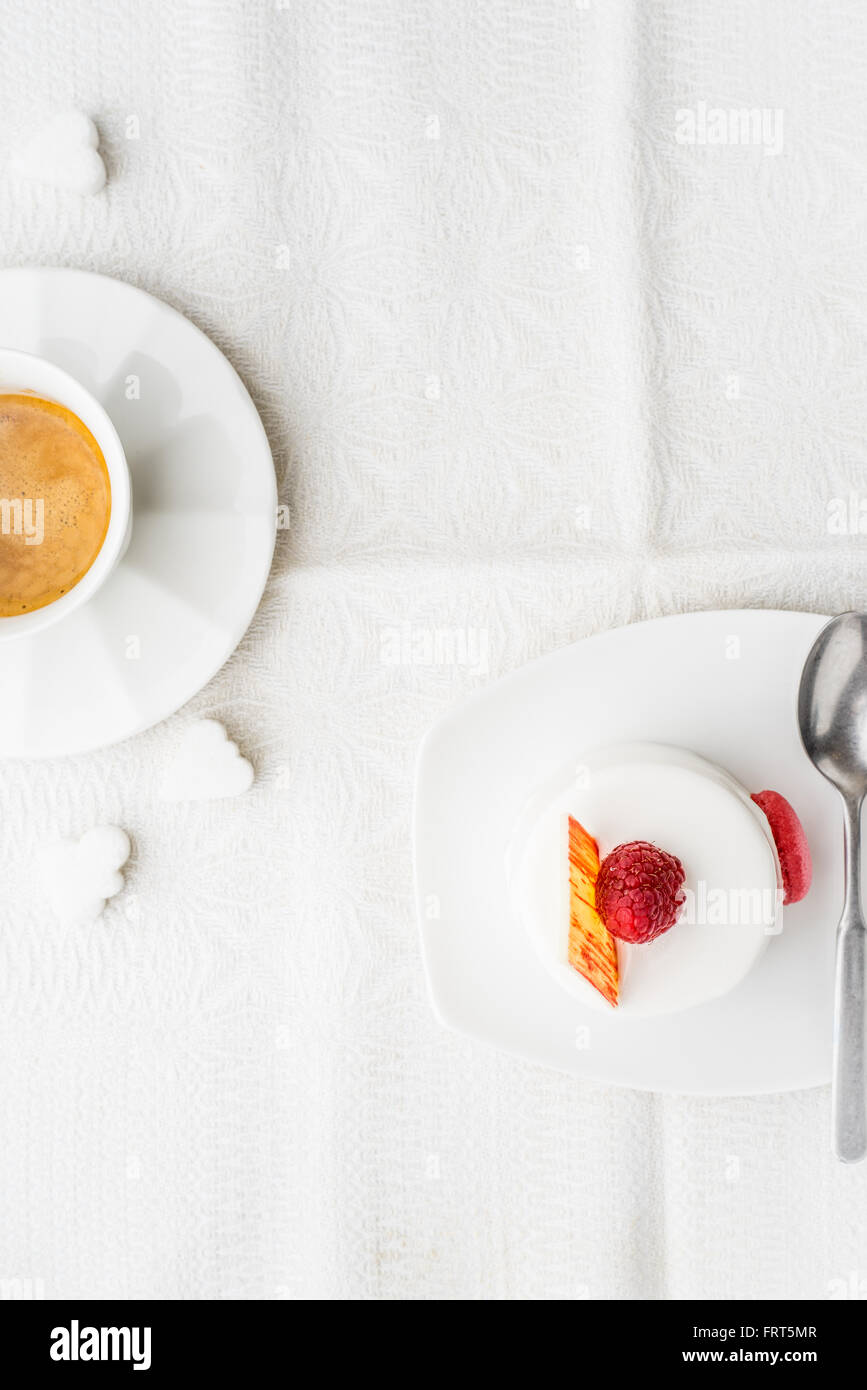White cake with raspberry and coffee vertical - Stock Image