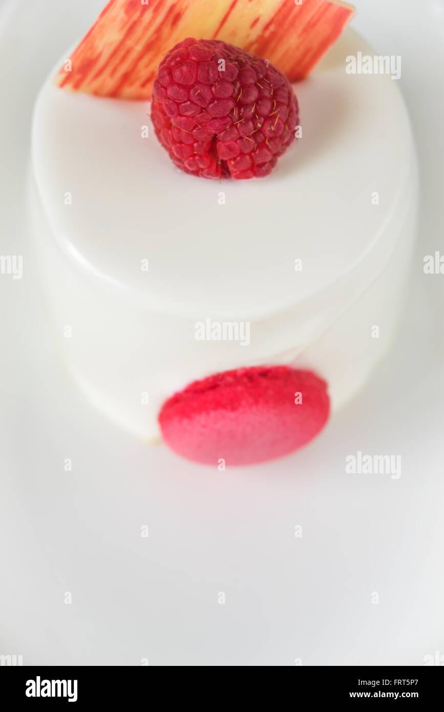 White cake with raspberry - Stock Image