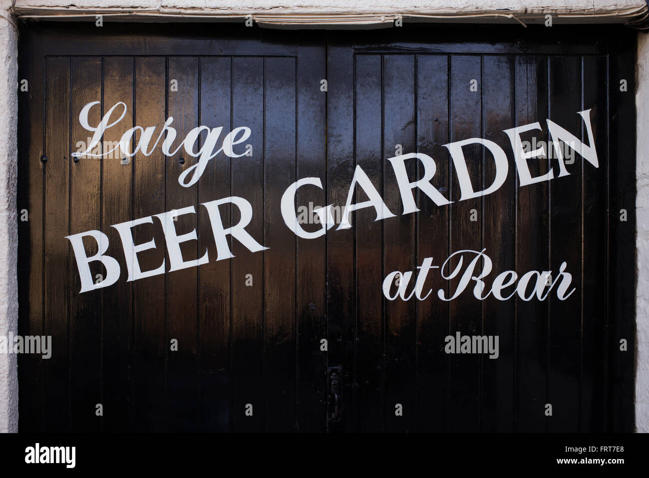 Large Beer Garden At Rear Sign Painted On A Pub Garage Doors Stock