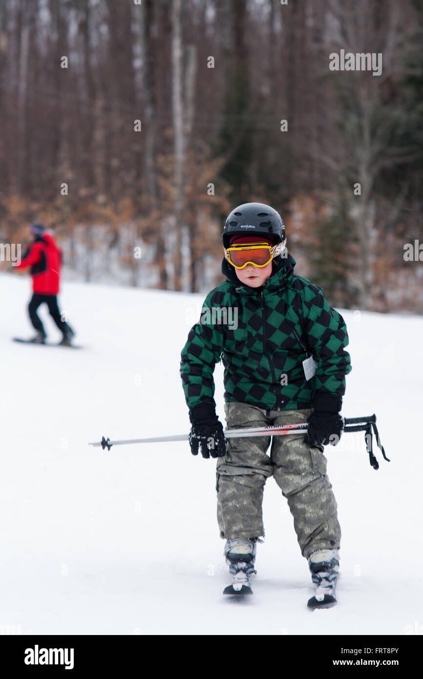 Young male learning to ski. Stock Photo