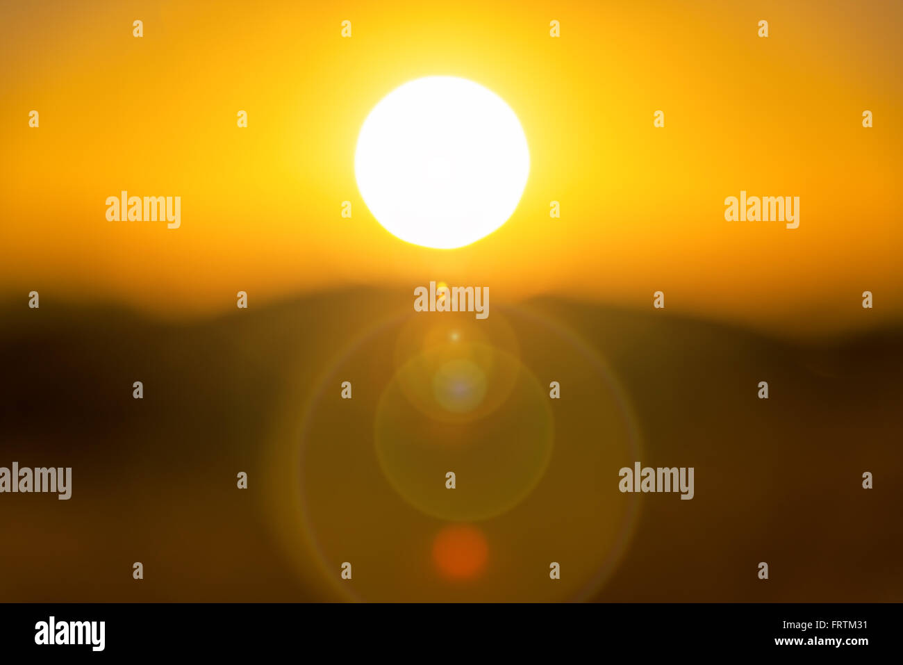 View of the sun with lens flare - Stock Image