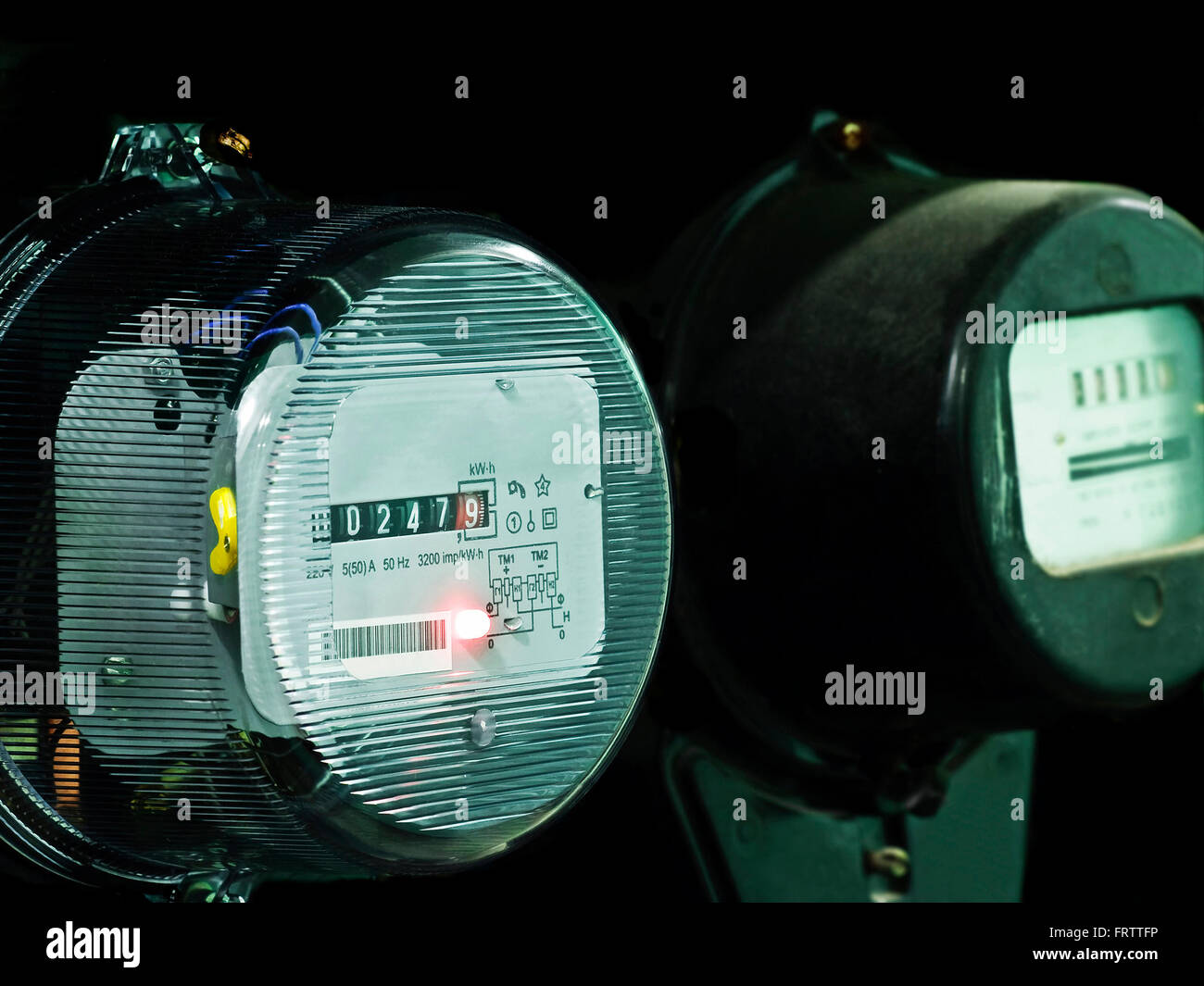 two electricity supply meters - Stock Image