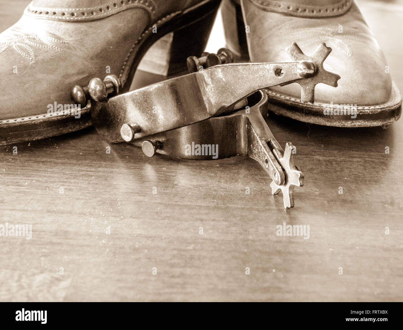 Boots and spurs; wood foreground - Stock Image