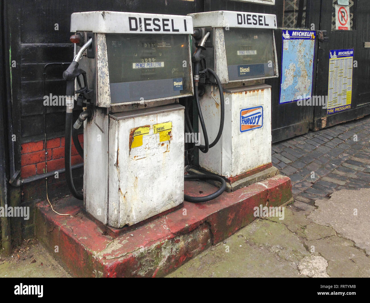 pair of old fashioned diesel pumps. - Stock Image