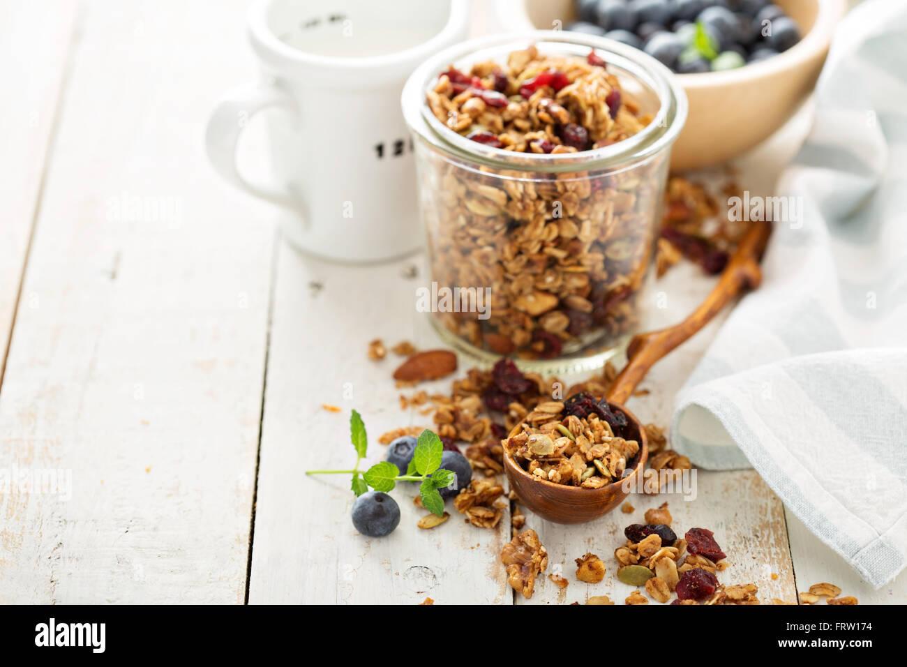 Homemade granola with milk for breakfast - Stock Image