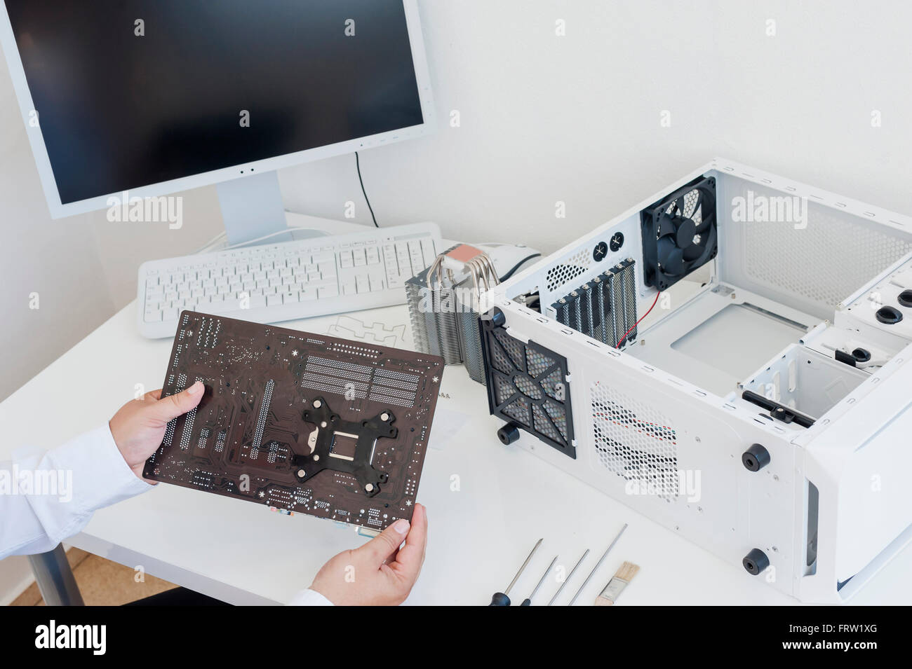 Assembling of a personal computer - Stock Image