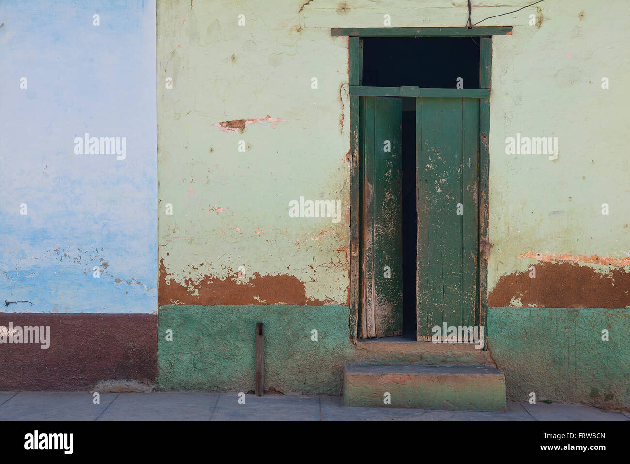 A wall of different colors and textures in the old Cuban town of Trinidad. - Stock Image