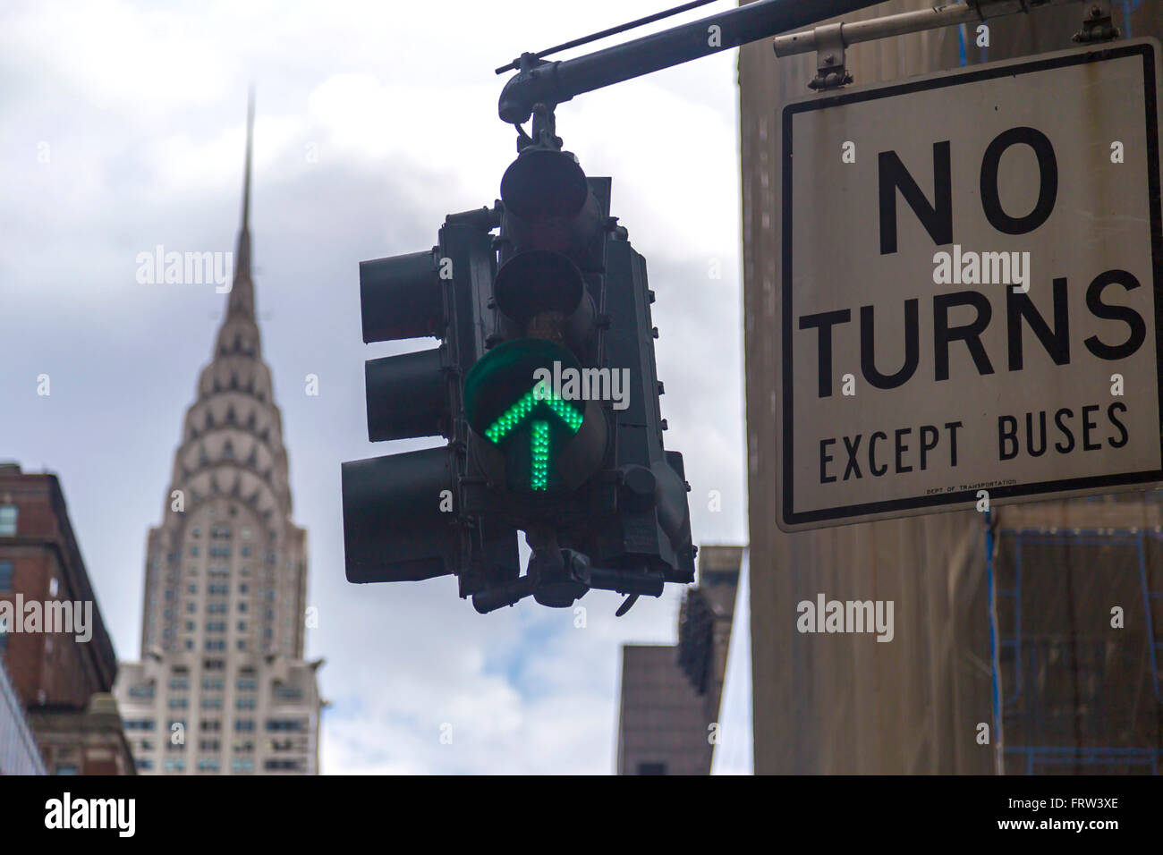 No turns road sign with green traffic light and the Chrysler building in background - Stock Image