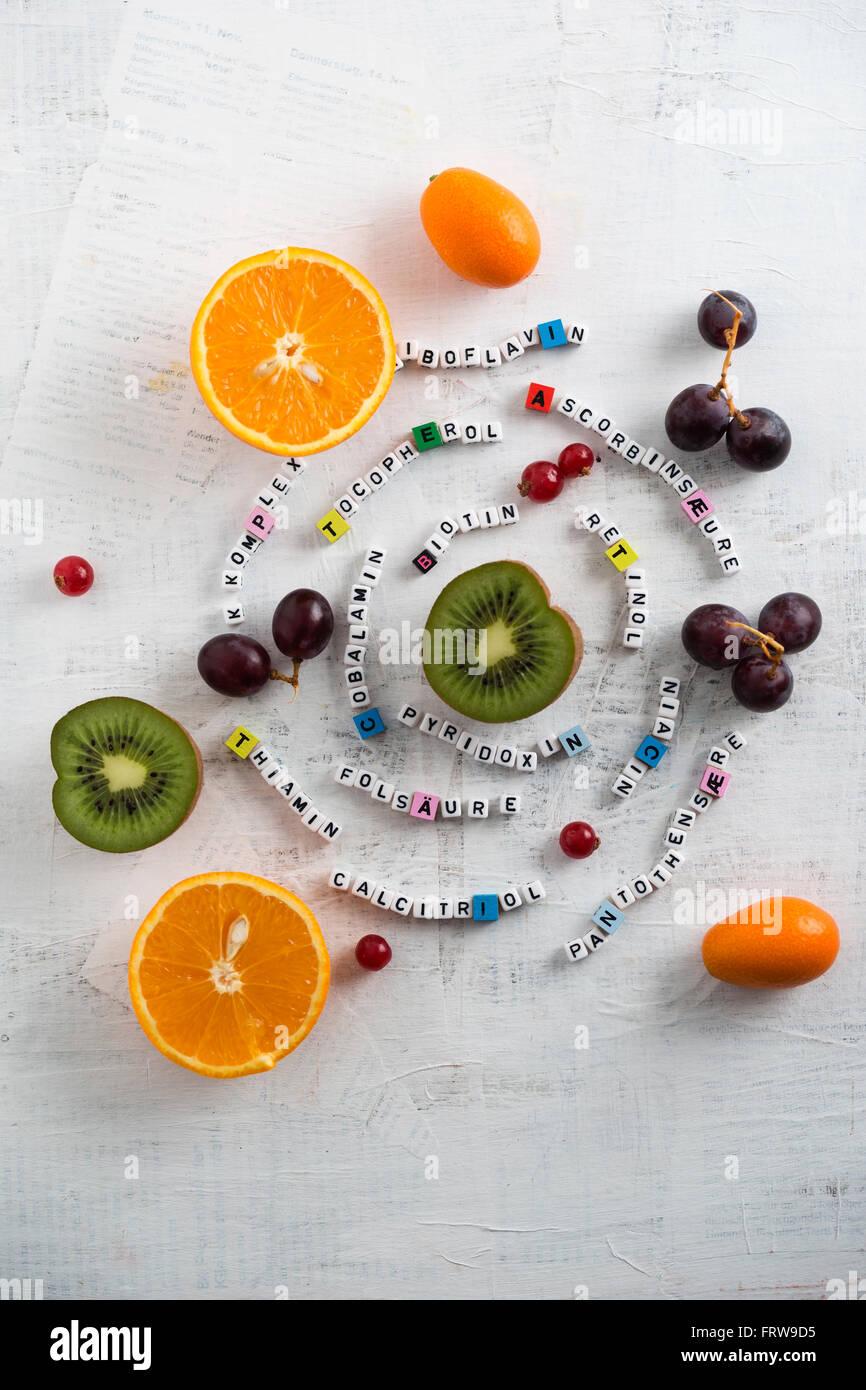 Fruits, orange, kiwi, grapes, currant and kumquat, different vitamins - Stock Image
