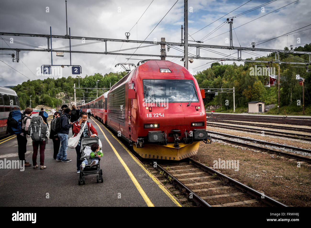 Modern train near the platform - Stock Image