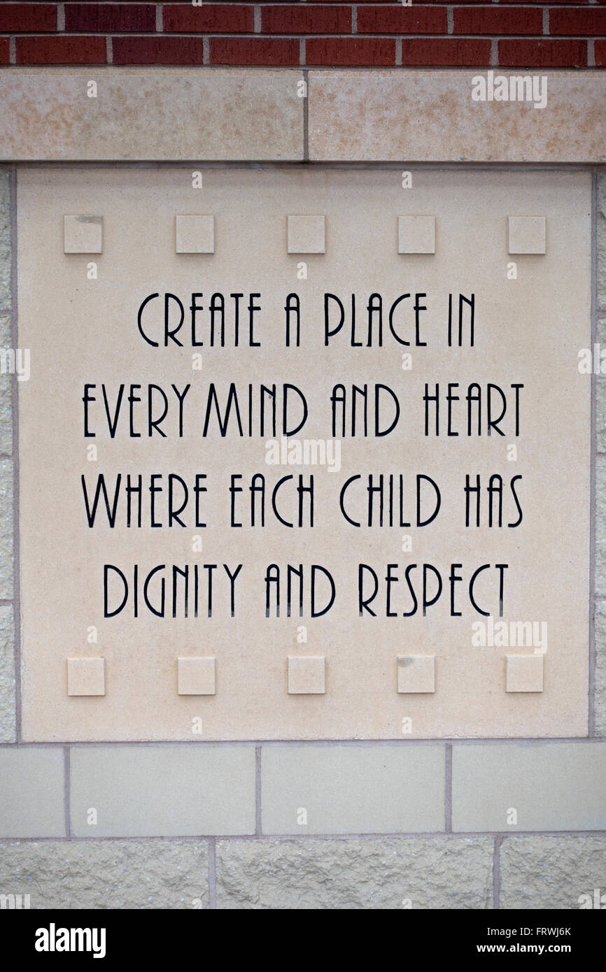 Carved message on side of building declaring dignity and respect for each child. St Paul Minnesota MN USA - Stock Image