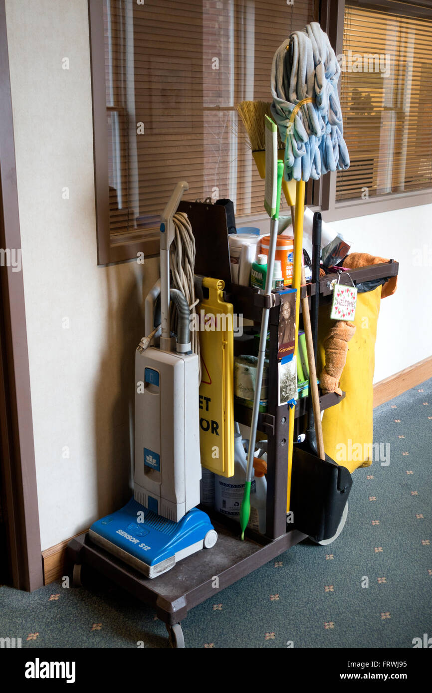 Vacuum mop and other cleaning supplies on wheels waiting for their master. St Paul Minnesota MN USA - Stock Image
