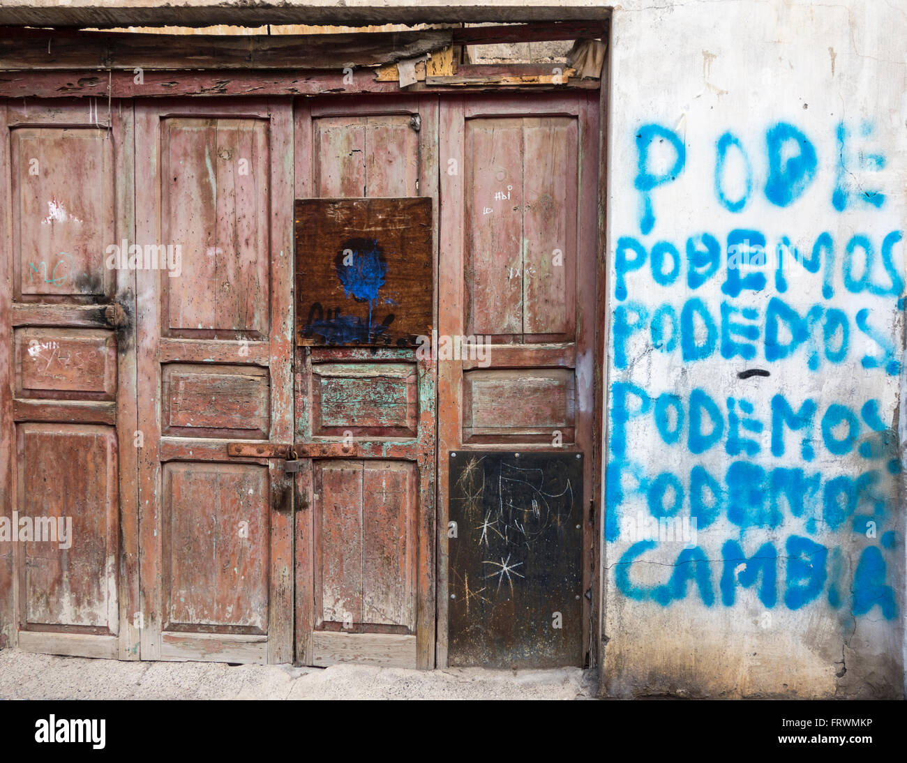 Podemos (we can in English) painted on wall of empty house during Spanish elections - Stock Image