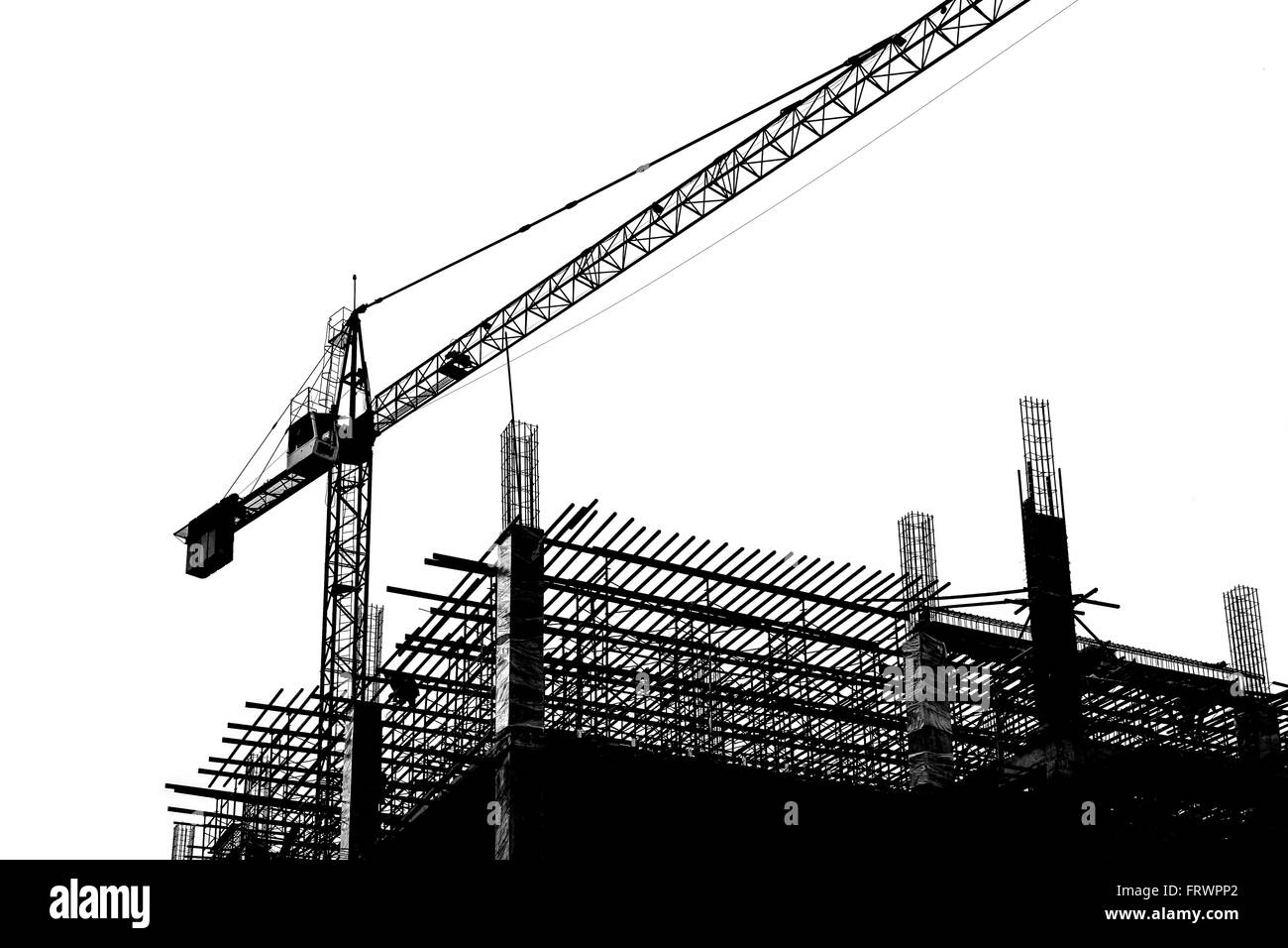 crane in construction site, abstract background, black and white - Stock Image
