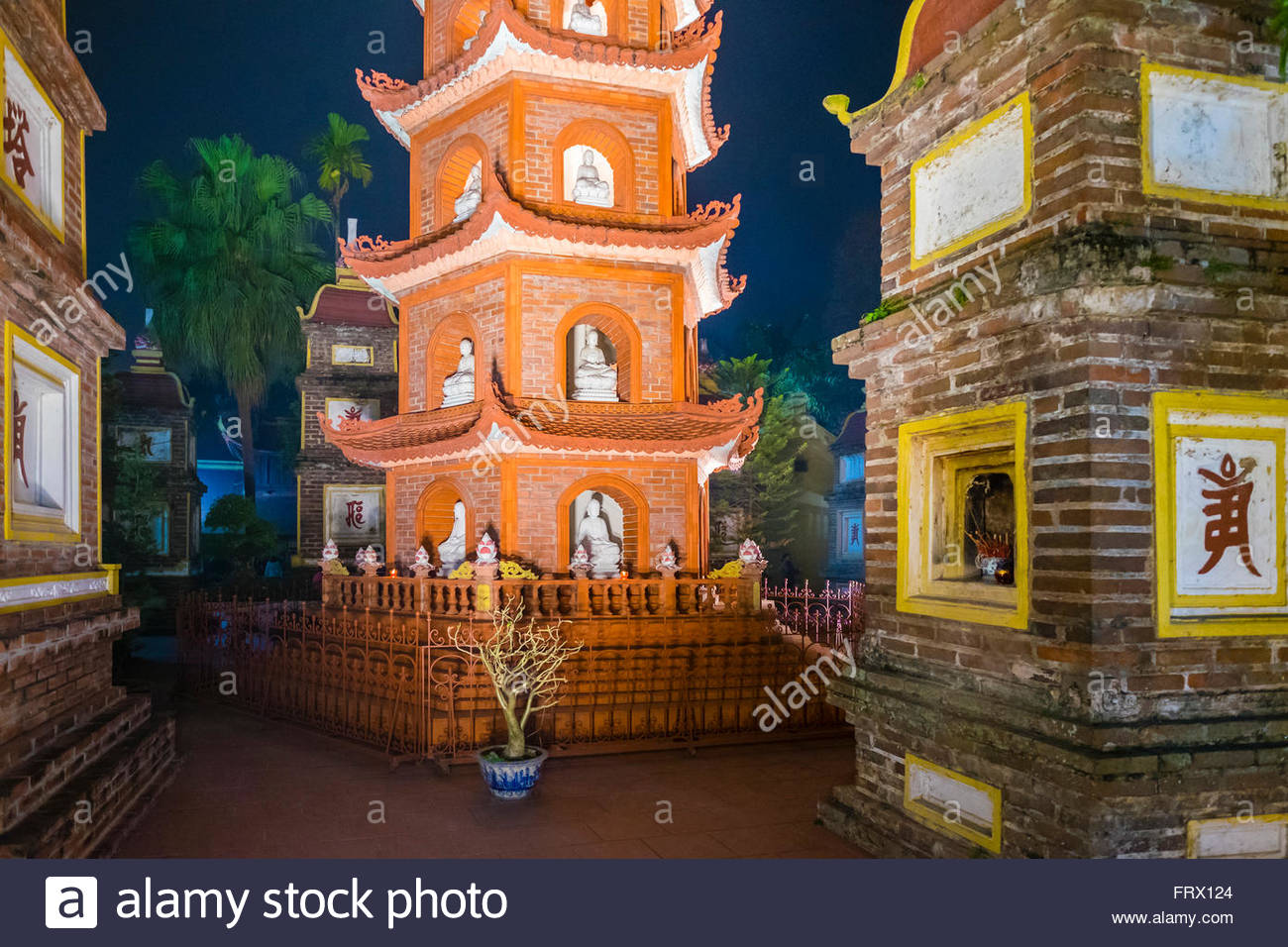 Tran Quoc Pagoda (Chua Tran Quoc) at night, Tay Ho District, Hanoi, Vietnam Stock Photo