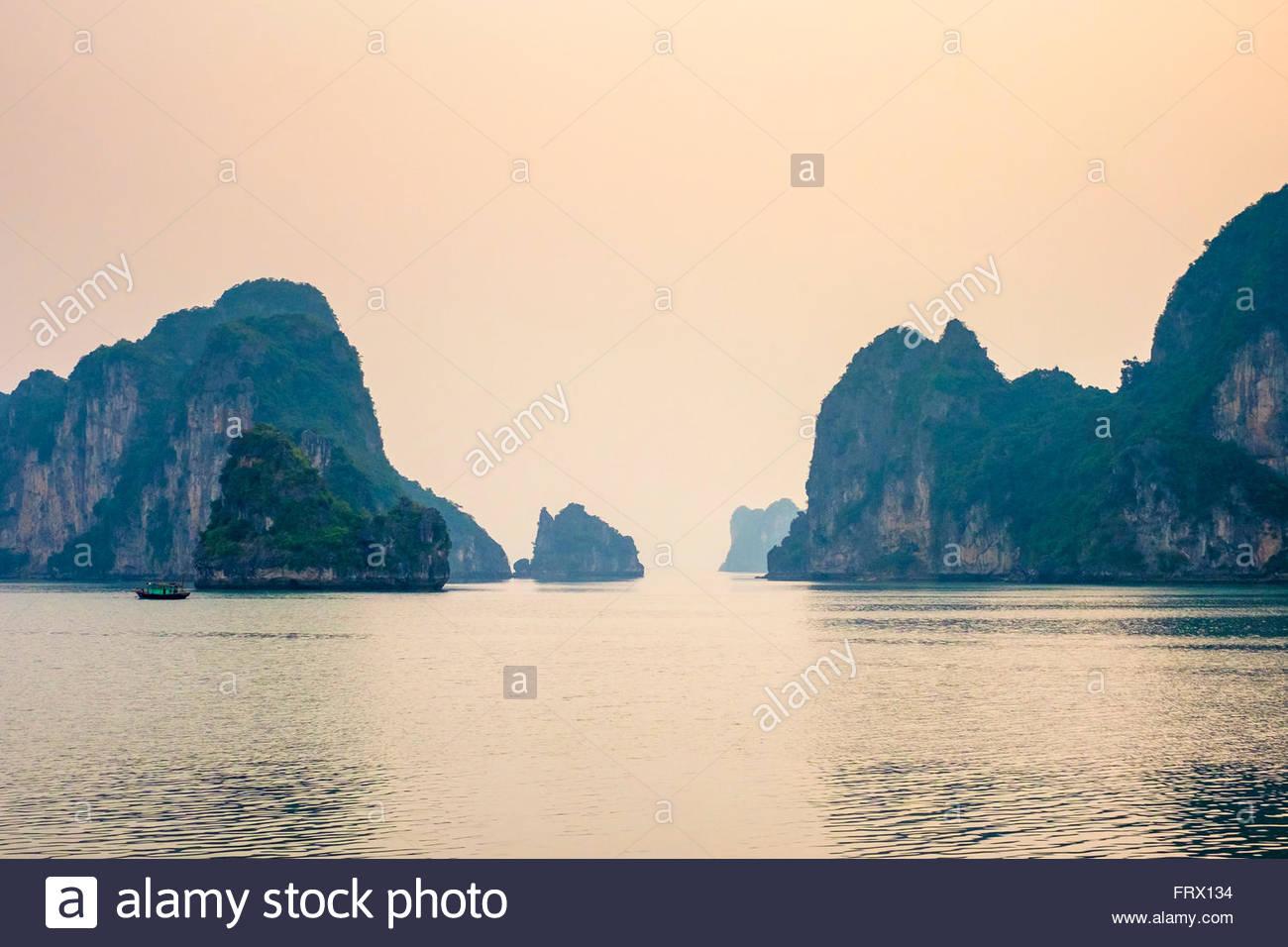 Karst mountain landscape in Ha Long Bay after sunset, Quảng Ninh Province, Vietnam Stock Photo