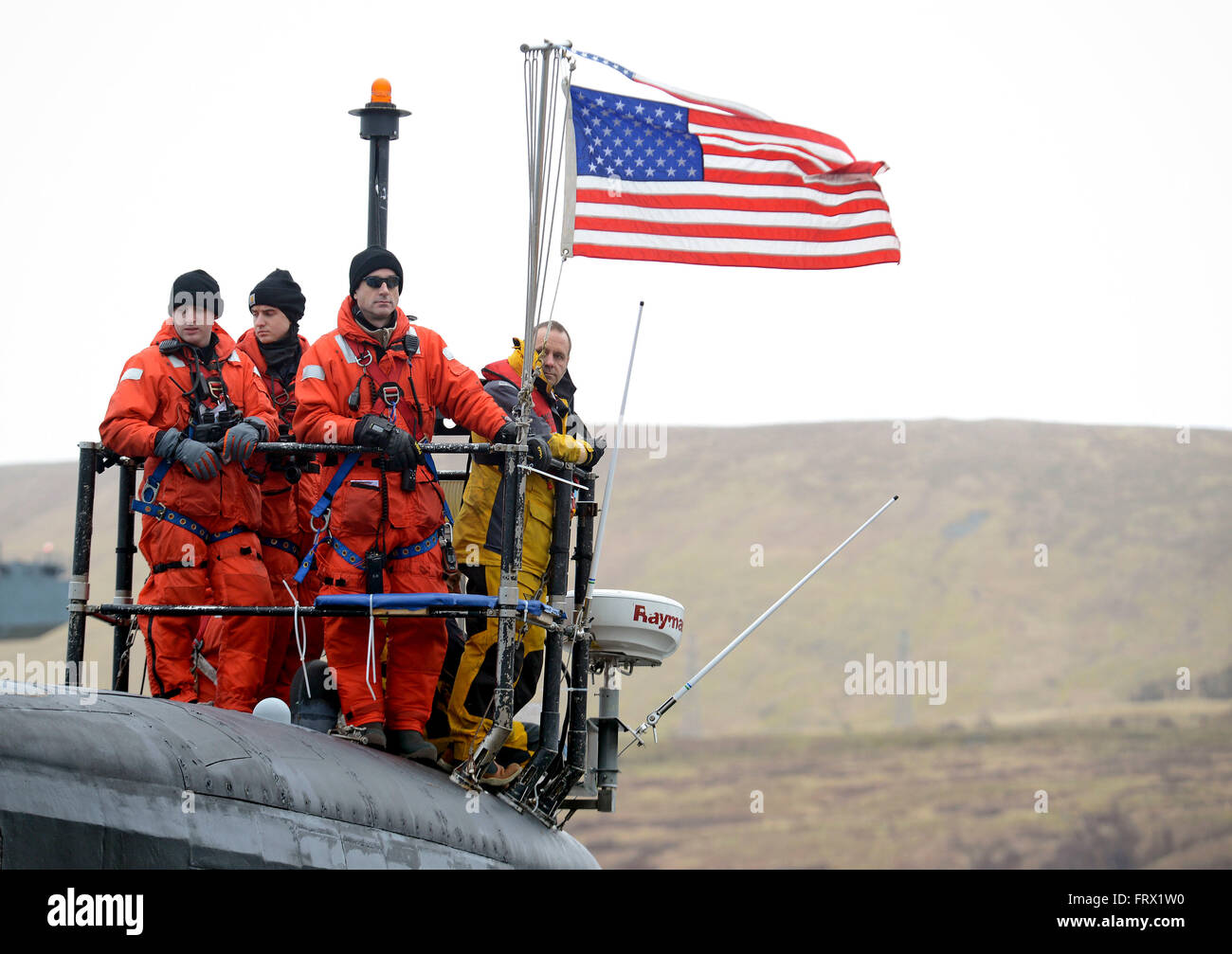 U.S Navy sailors stand on the conning tower of the Virginia-class attack submarine USS Virginia at she arrives at - Stock Image