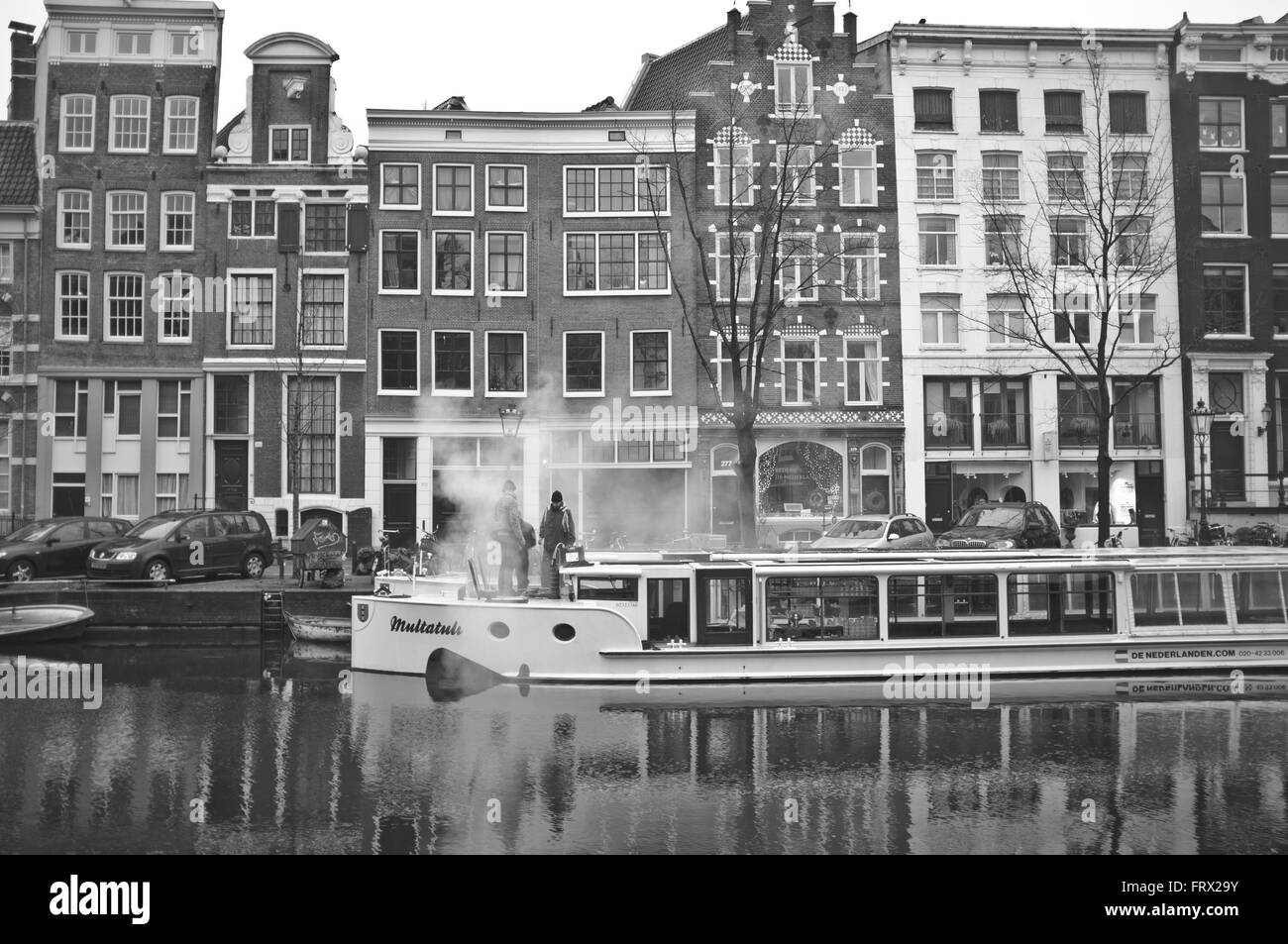 Broken Cruise Boat in Amsterdam Netherlands EU - Stock Image