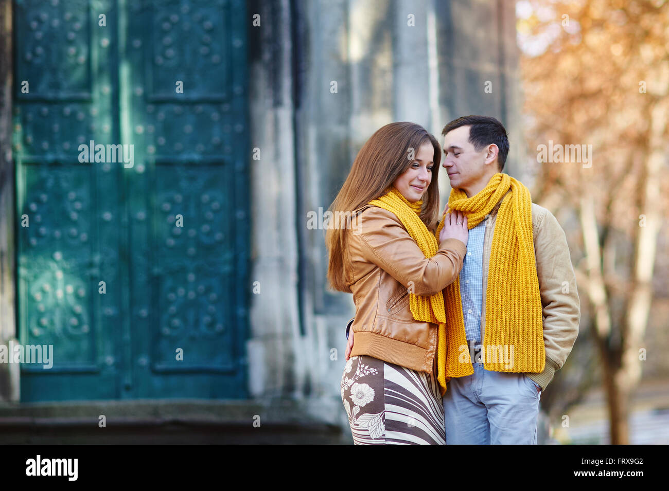 Cheerful couple walking through the city together Stock Photo