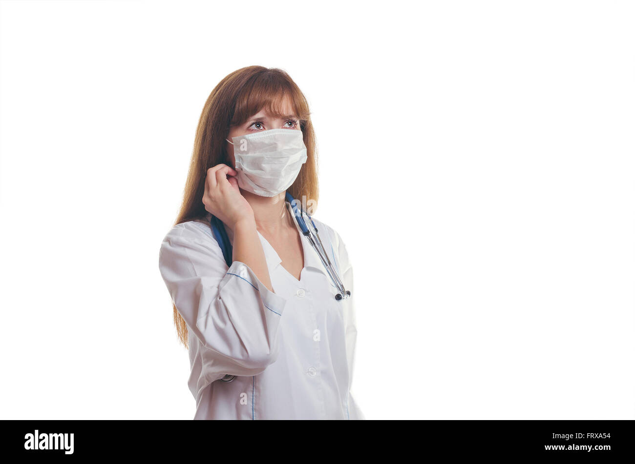 The young doctor in a medical mask - Stock Image