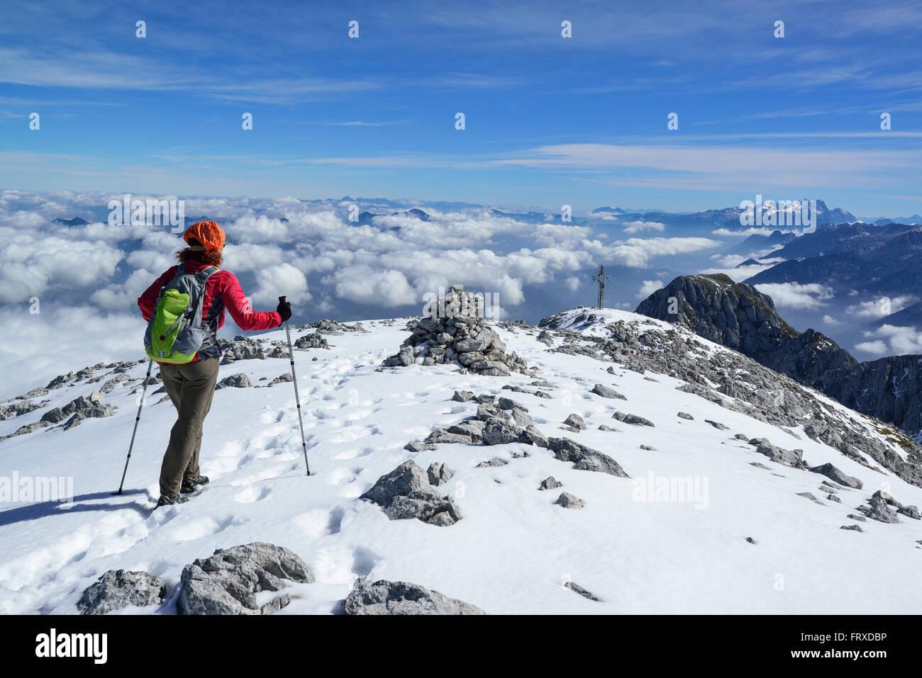 Woman descending from Hoher Goell, Dachstein range in background, Berchtesgaden National Park, Berchtesgaden Alps, Stock Photo