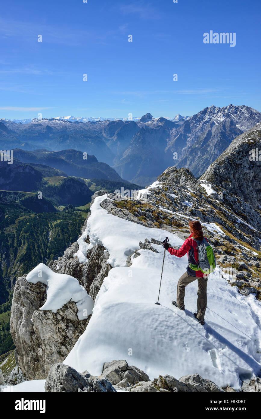 Woman ascending to Hohes Brett, Hundstod and Watzmann massif in background, Hoher Goell, Berchtesgaden National Stock Photo