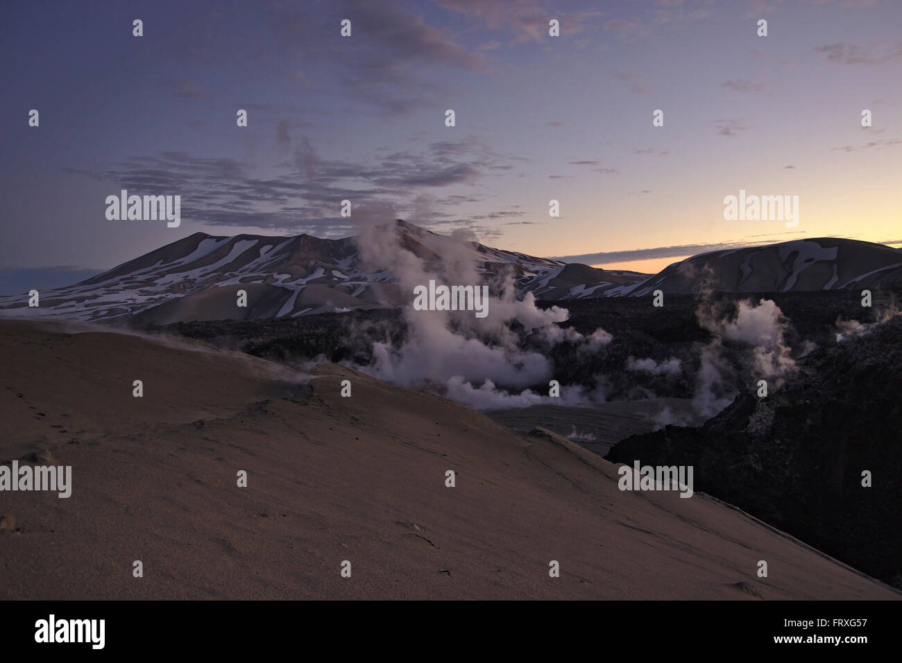 Fumaroles and lava flow in Cordon Caulle, Puyehue in the back, dusk, Chile - Stock Image
