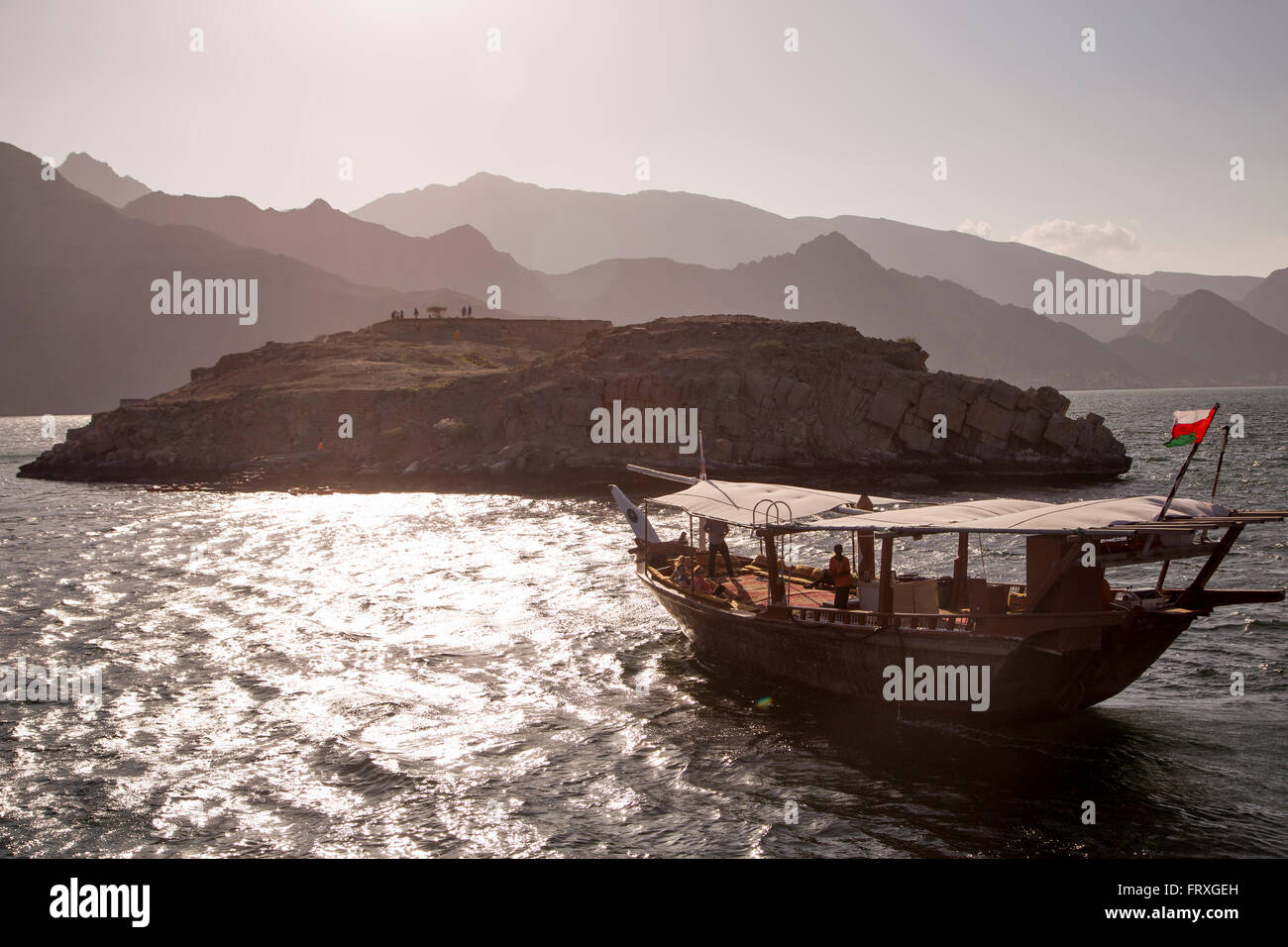 Traditional dhow boat excursion to Telegraph Island in the fjord of Musandam Peninsula, near Khasab, Oman - Stock Image