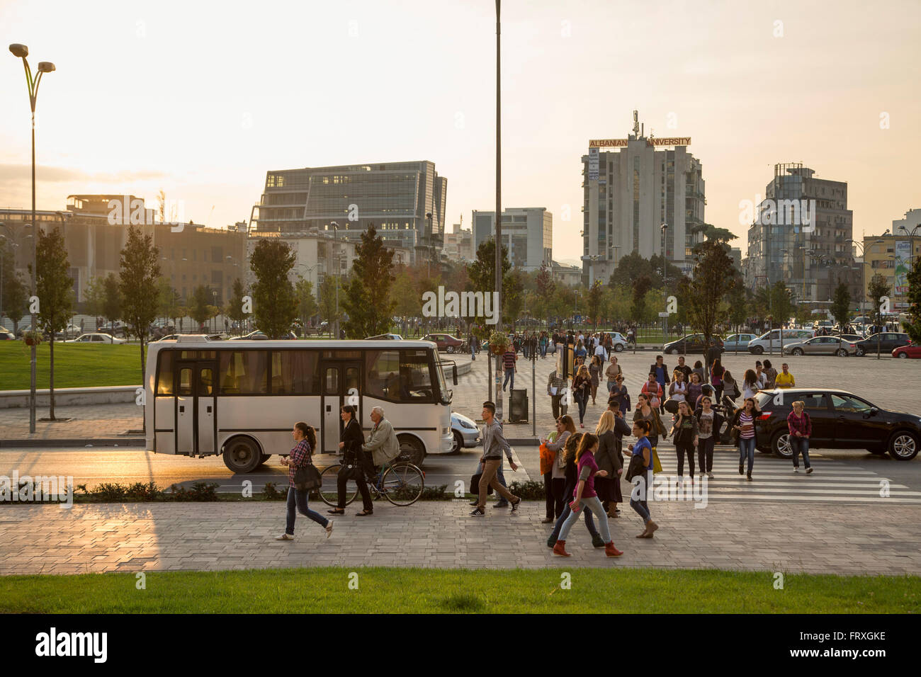 Pedestrians and Traffic near Skanderbeg Square at sunset, Tirana, Albania - Stock Image