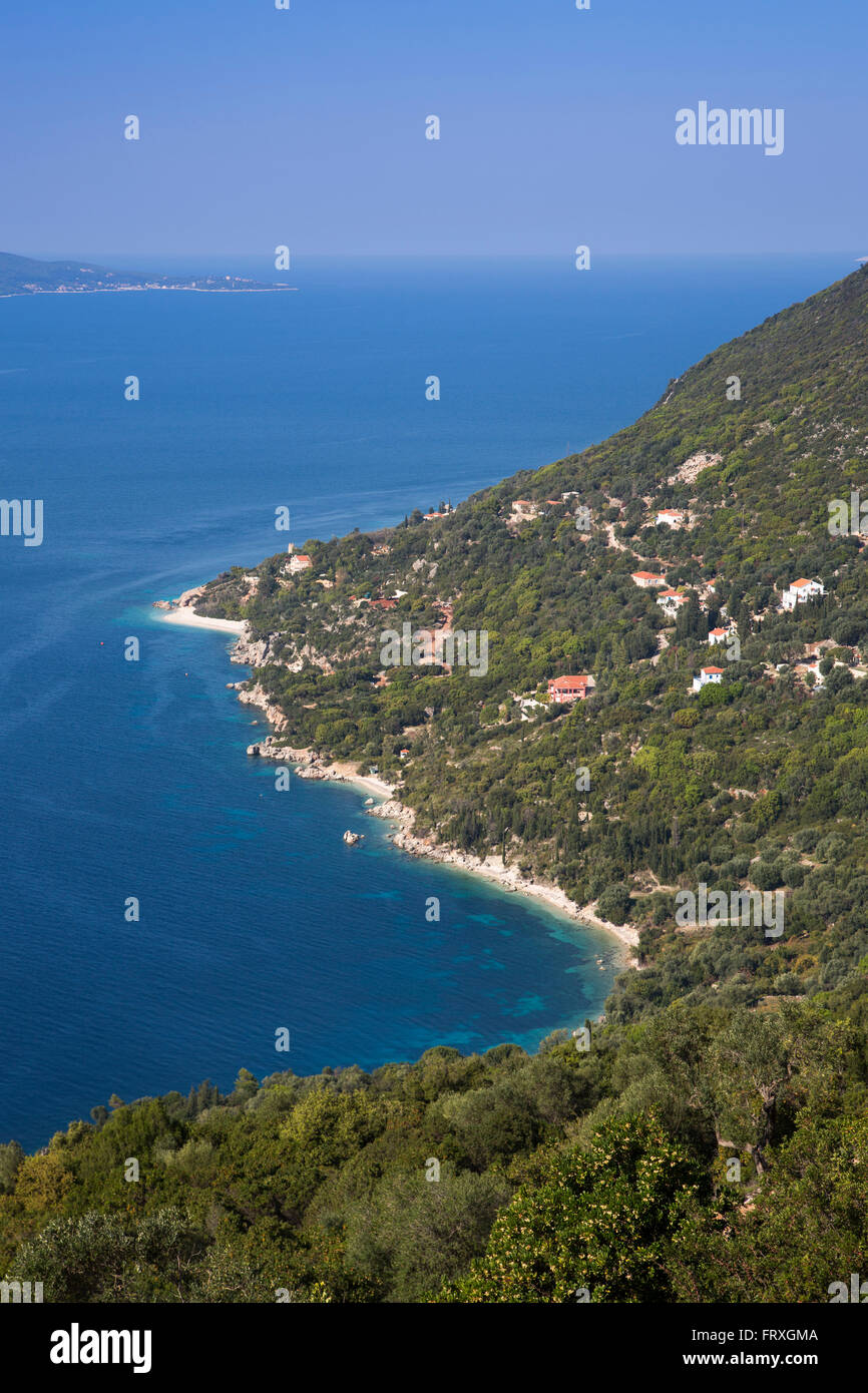 Cliffside houses, beach and coastline, near Lefki, Ithaca, Ionian Islands, Greece - Stock Image