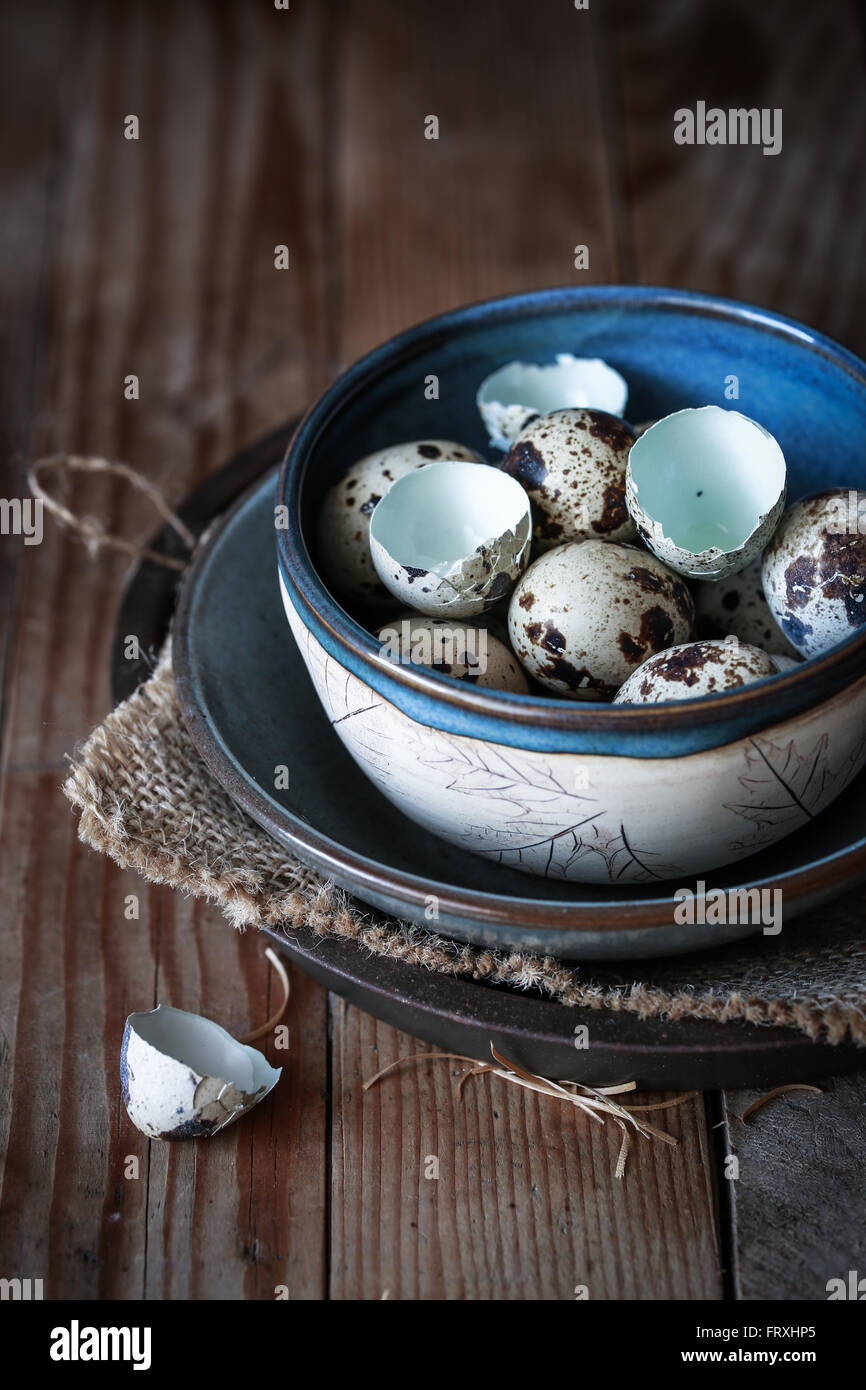 Quail eggs in a bowl - Stock Image