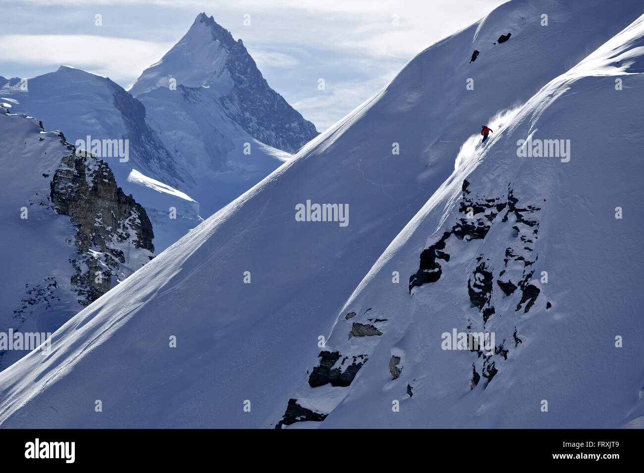 Freeskier downhill skiing in deep snow, Chandolin, Canton of Valais, Switzerland Stock Photo