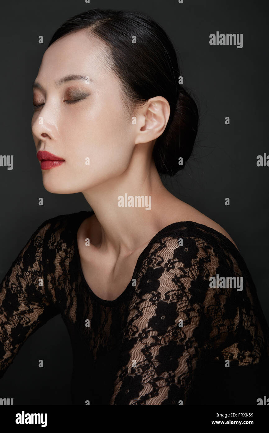 Beautiful Asian woman beauty make up shot, eyes closed - Stock Image