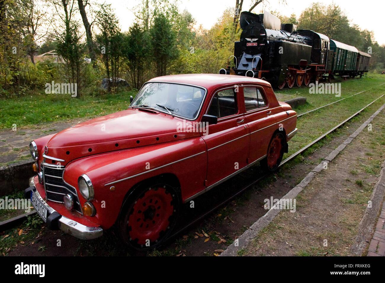 Car and steam locomotive, Bialowieza National Park, Podlaskie Voivodeship, Poland - Stock Image