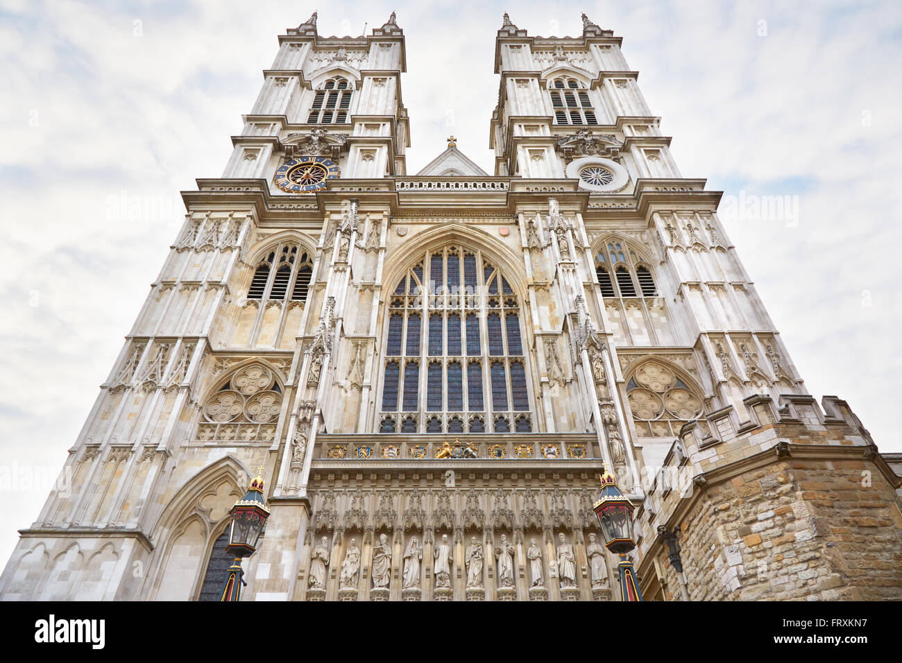 Westminster Abbey church facade on cloudy sky in London - Stock Image