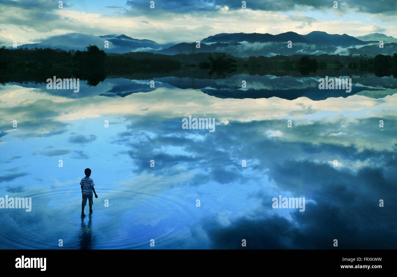 Boy walking in peace lake concept art - Stock Image